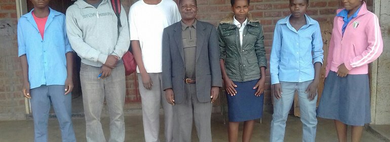 IFFD Official, headmaster and bursary beneficiaries in Salima